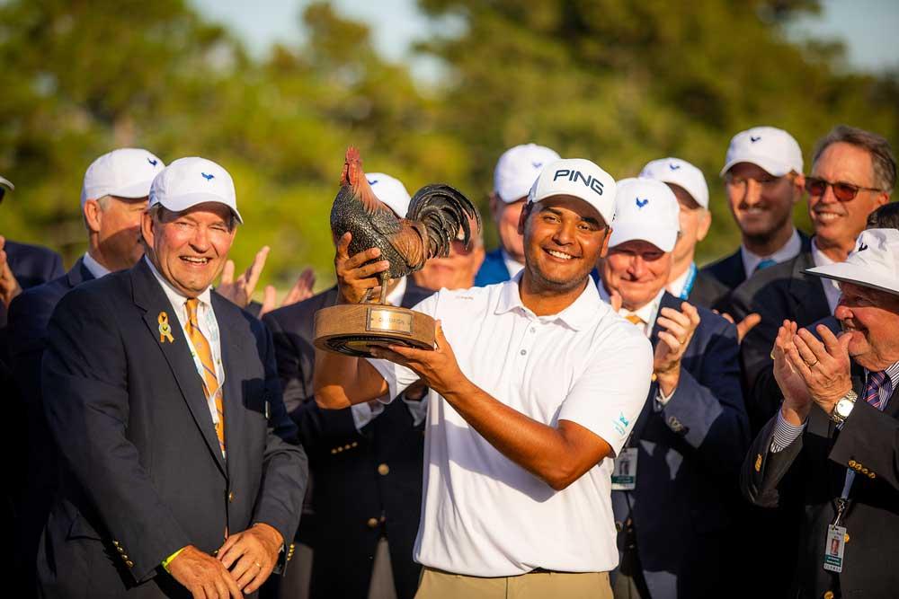 Colombian Golfer Sebastián Muñoz holding Sanderson Farms Championship trophy.