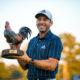 Sergio Garcia holding the 2020 Sanderson Farms Championship trophy